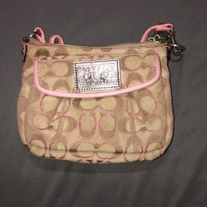 Small Coach crossbody bag. Pink and beige